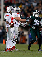 Ohio State Buckeyes quarterback J.T. Barrett (16) throws his hands up after a delay of game penalty during the first quarter of the NCAA football game at Spartan Stadium in East Lansing, Michigan on Nov. 8, 2014. (Adam Cairns / The Columbus Dispatch)