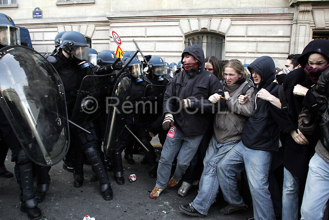 """©REMI OCHLIK/IP3; PARIS, FRANCE LE 14/03/06 - HEURTS ENTRE CRS ET MANIFESTANT ANTI-CPE DANS LE QUARTIER DE LA SORBONNE....The contrat premiere embauche (CPE), translated first employment contract, was a new form of employment contract pushed in spring 2006 in France by Prime Minister Dominique de Villepin. This employment contract, available solely to employees under 26, would have made it easier for the employer to fire employees by removing the need to provide reasons for dismissal for an initial """"trial period"""" of two years, in exchange for some financial guarantees for employees. ....The law has met heavy resistance from students, trade unions, and left-wing activists, sparking protests in February and March 2006 (and continuing into April) with hundreds of thousands of participants in over 180 cities and towns across France"""