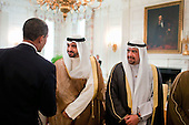 Washington, DC - August 3, 2009 -- United States President Barack Obama greets members of the delegation traveling with Al-Ahmad Al-Jaber Al-Sabah, the Amir of Kuwait, during a lunch in the Old Family Dining Room of the White House, August 3, 2009. .Mandatory Credit: Pete Souza - White House via CNP