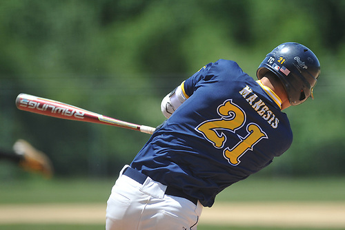 Nick Manesis #21 of Shoreham-Wading River follows through on a swing during the Class A varsity baseball Long Island Championship against Wantagh at SUNY Old Westbury on Saturday, June 3, 2017.