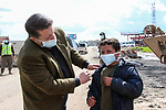 A photo taken on March 30, 2020, shows Syrians wearing a mask as a preventive measure amid fears of the spread of the coronavirus disease (COVID-19) in the northern Syrian city of Azaz. Photo by Nayef ALaboud