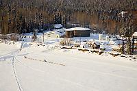 Aerial of Norwegian couple Tove Sorenson & Tore Albrightsen leave McGrath Chkpt YukonRiver 06Iditarod