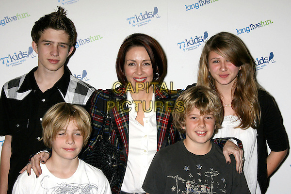 PATRICIA HEATON & FAMILY .77kids Launch Party Clothing Line by American Eagle hosted by the Jonas Brothers held at The Roxy, Los Angeles, California, USA, 14th November 2008..half length children kids tartan jacket sons daughter .CAP/ADM/MJ.©Michael Jade/Admedia/Capital Pictures