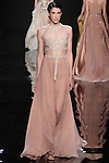 """Model walks runway in a nude silk chiffon dress with embroidered detail from the Reem Acra Fall 2016 """"The Secret World of The Femme Fatale"""" collection, at NYFW: The Shows Fall 2016, during New York Fashion Week Fall 2016."""