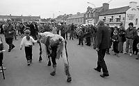1993 St Patrick's Day Parade Sneem, County Kerry Ireland.  'Big Bertha', having reached the age of 48 years and appearing in the Guinness Book of Records as the world's oldest cow is grand marshall at the annual St. patrick's Day Parade in Sneem Country Kerry. In this photograph Big Bertha is led by a local girl throught the streets of the village. She died a few montha later on New Year's Eve 1993.<br /> Photo: Don MacMonagle <br /> e: info@macmonagle.com