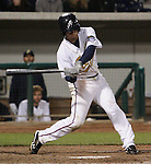 Reno Aces Chris Owings lines a double against the Sacramento River Cats during their game played on Friday night, April 12, 2013 in Reno, Nevada.