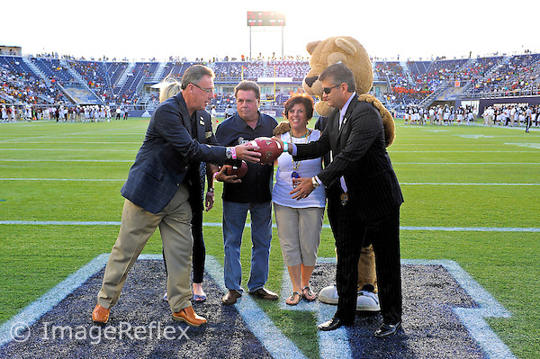 14 September 2013:  FIU Executive Director of Sports and Entertainment Pete Garcia presents the game ball at the end of the first quarter as the Bethune-Cookman Wildcats defeated the FIU Golden Panthers, 34-13, at FIU Stadium in Miami, Florida.