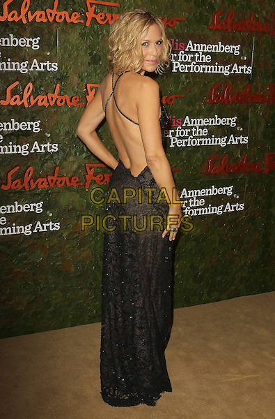 Maria Bello<br /> Wallis Annenberg Center For The Performing Arts Inaugural Gala held at Wallis Annenberg Center For The Performing Arts,  Beverly Hills, California, USA, 17th October 2013.<br /> full length black lace dress strappy back over shoulder rear behind <br /> CAP/ADM/KB<br /> &copy;Kevan Brooks/AdMedia/Capital Pictures
