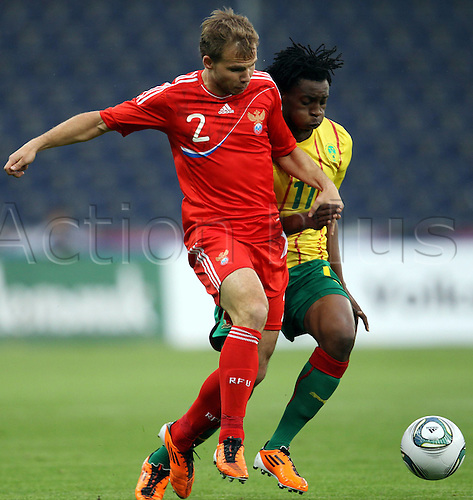 07.06.2011 International Friendly from Salzburg in Austria. Cameroon v Russia. Picture shows Novel Shishkin RUS and Benjamin Moukandjo CMR