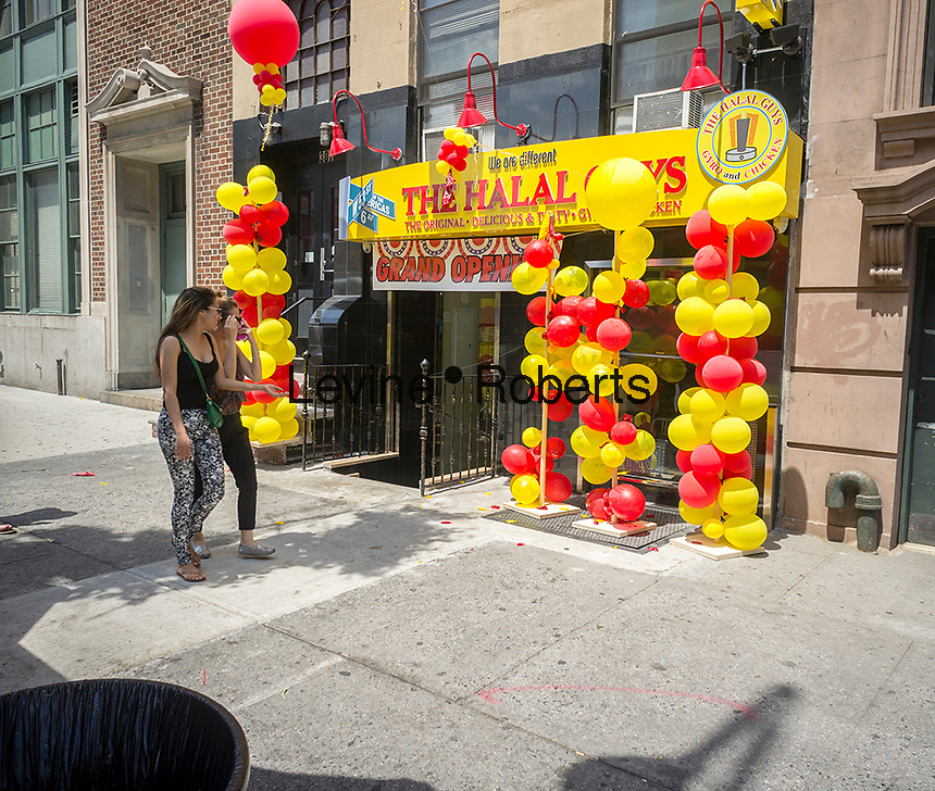 The new restaurant of the popular Halal Guys food cart chain in the East Village neighborhood of New York on Saturday, June 28, 2014. The mini-industry of middle-eastern food, which already has five locations opened its permanent restaurant with another set to open shortly near Columbia University. They have signed a deal with Fransmart, a firm that advises restaurants on franchising. Fransmart worked with Five Guys Burger and Fries which grew to over 1200 locations. (© Richard B. Levine)