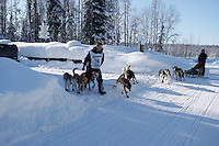 Heading to a 2nd place finish, Travis Beals moves his team back on to the trail after they veered into a nearby driveway nearing the finish line of the 2009 Junior Iditarod in Willow, Alaska.   March 1, 2009