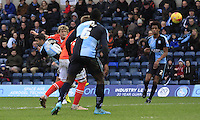 Cameron McGeehan of Luton Town scores the winning goal during the Sky Bet League 2 match between Wycombe Wanderers and Luton Town at Adams Park, High Wycombe, England on 6 February 2016. Photo by Liam Smith.
