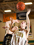 02/04/11--Rex Putnam's Jacob Garrison fends off Milwaukie's Bobby McVeigh for a rebound..Photo by Jaime Valdez