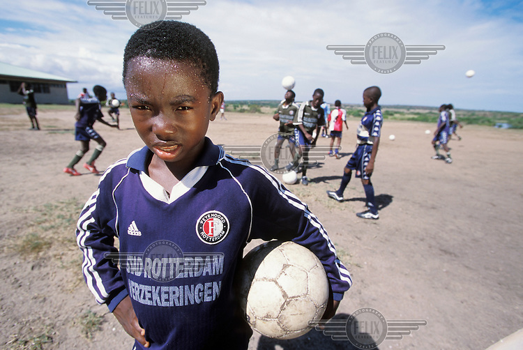 Young boy at a school which is funded by the Dutch football club Feyenoord. Football is, of course, played at the school, and two graduates are now full time members of the Rotterdam team.