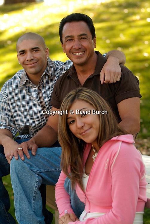 Hispanic man with his children