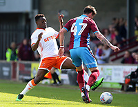 Blackpool's Marc Bola chases down Scunthorpe United's Adam Hammill<br /> <br /> Photographer David Shipman/CameraSport<br /> <br /> The EFL Sky Bet League One - Scunthorpe United v Blackpool - Friday 19th April 2019 - Glanford Park - Scunthorpe<br /> <br /> World Copyright © 2019 CameraSport. All rights reserved. 43 Linden Ave. Countesthorpe. Leicester. England. LE8 5PG - Tel: +44 (0) 116 277 4147 - admin@camerasport.com - www.camerasport.com