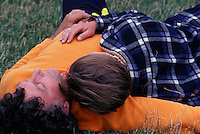 Couple relaxing on grass.