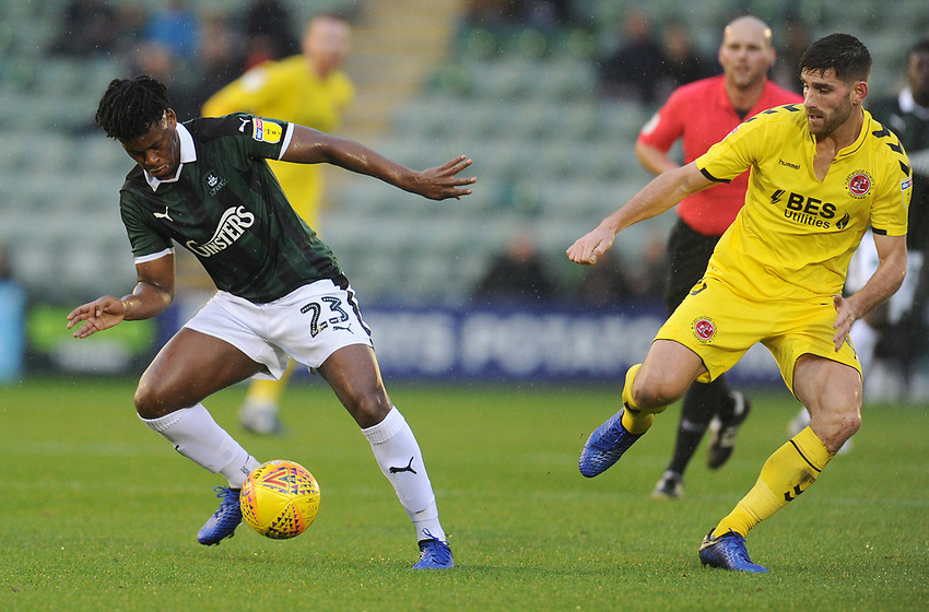 Plymouth Argyle's Ashley Smith-Brown under pressure from Fleetwood Town's Ched Evans<br /> <br /> Photographer Kevin Barnes/CameraSport<br /> <br /> The EFL Sky Bet League One - Plymouth Argyle v Fleetwood Town - Saturday 24th November 2018 - Home Park - Plymouth<br /> <br /> World Copyright © 2018 CameraSport. All rights reserved. 43 Linden Ave. Countesthorpe. Leicester. England. LE8 5PG - Tel: +44 (0) 116 277 4147 - admin@camerasport.com - www.camerasport.com