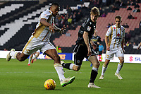 Chuks Aneke of MK Dons and Ryan Lloyd of Macclesfield Town during MK Dons vs Macclesfield Town, Sky Bet EFL League 2 Football at stadium:mk on 17th November 2018