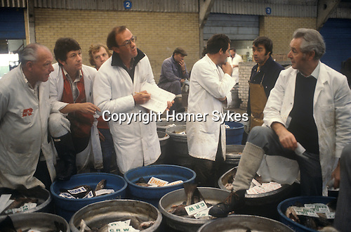 The nights catch is auctioned off. Fishing industry Fleetwood Lancashire Uk 1980s