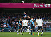 Danny Rowe of Wycombe Wanderers rises high to win the ball in the air during the Capital One Cup match between Wycombe Wanderers and Fulham at Adams Park, High Wycombe, England on 11 August 2015. Photo by Andy Rowland.