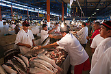 BRAZIL, Manaus, man buying fish being sold at the Manaus fish market