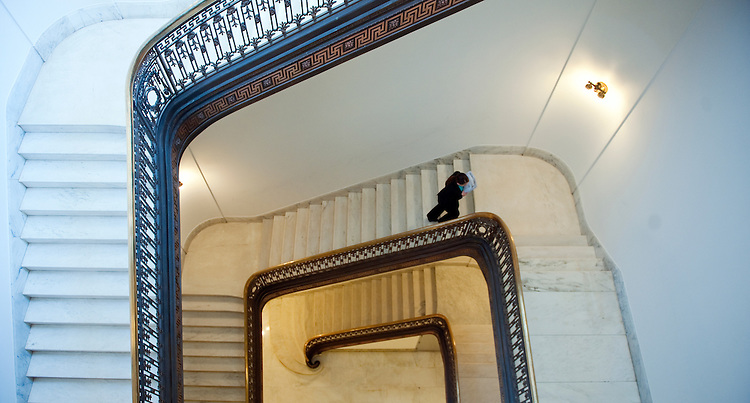 UNITED STATES - FEB 25: A staffer carrying papers takes the stairs in the Russell Senate Office Building on February 25, 2013.  (Photo By Douglas Graham/CQ Roll Call)