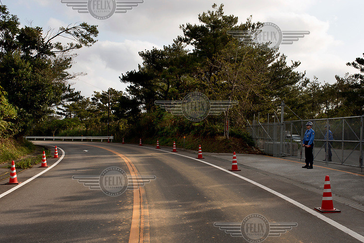 Police guard one of the gates to the US army's Jungle Warfare Training Center, in the Takae district.