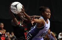 24.02.2018 Malawi's Sindi Simtowe and Fiji's Alisi Naqiri in action during the Malawi v Fiji Taini Jamison Trophy netball match at the North Shore Events Centre in Auckland. Mandatory Photo Credit ©Michael Bradley.
