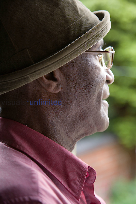 Elderly man gazing out of the window.  MR