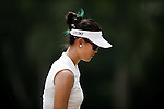 CHON BURI, THAILAND - FEBRUARY 16:  Michelle Wie of USA walks off the 8th green during day one of the LPGA Thailand at Siam Country Club on February 16, 2012 in Chon Buri, Thailand.  Photo by Victor Fraile / The Power of Sport Images