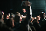 "© Joel Goodman - 07973 332324. 03/11/2017 . Manchester , UK . TOMMY ROBINSON (real name Stephen Yaxley-Lennon ) speaks to supporters at the launch of the former EDL leader's book "" Mohammed's Koran "" at Castlefield Bowl . Originally planned as a ticket-only event at Bowlers Exhibition Centre , the launch was moved at short notice to a public location in the city . Photo credit : Joel Goodman"