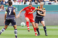 Abby Wambach #20 of the Washington Freedom battles Allison Faulk #7 of the Los Angeles Sol for control of the ball during their inaugural match at Home Depot Center on March 29, 2009 in Carson, California.