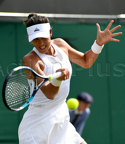 July 6th 2017, All England Lawn Tennis and Croquet Club, London, England; The Wimbledon Tennis Championships, Day 4;  Garbine Muguruza (ESP) returns to Yanina Wickmayer of Belgium