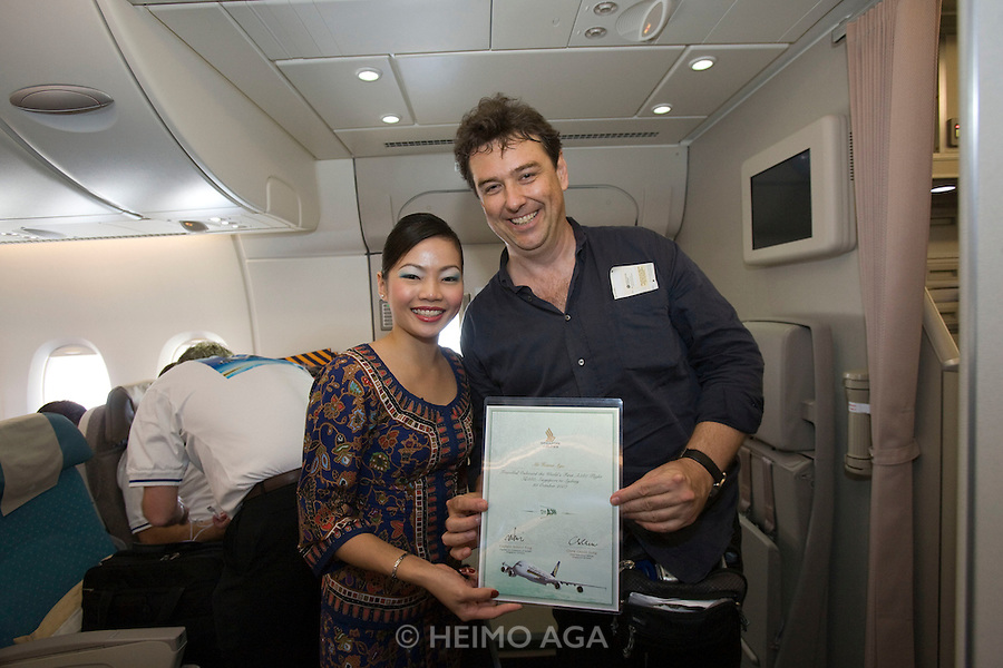 Airbus A380 first commercial flight - Singapore Airlines SQ 380 Singapore-Sydney on October 25, 2007. Heimo Aga and Singapore girl.