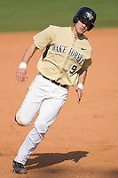 Austin Stadler #9 of the Wake Forest Demon Deacons rounds third base to score a run in the bottom of the 9th inning versus the Boston College Eagles at Wake Forest Baseball Park April 11, 2009 in Winston-Salem, NC. (Photo by Brian Westerholt / Four Seam Images)