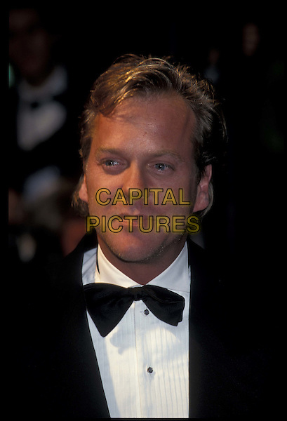 KIEFFER SUTHERLAND.Cannes Film Festival.May 1998.Ref:7 424.kiefer keiffer keffer, bow tie, headshot, portrait.*RAW SCAN- photo will be adjusted for publication*.www.capitalpictures.com.sales@capitalpictures.com.©Capital Pictures