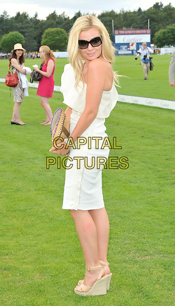 KATHERINE JENKINS .at the Cartier International Polo, Windsor Great Park, Windsor, Berkshire, England, UK, 26th July 2010..full length beige cream one shoulder ruffle dress wedges sunglasses  clutch bag espardrilles.CAP/CAN.©Can Nguyen/Capital Pictures.