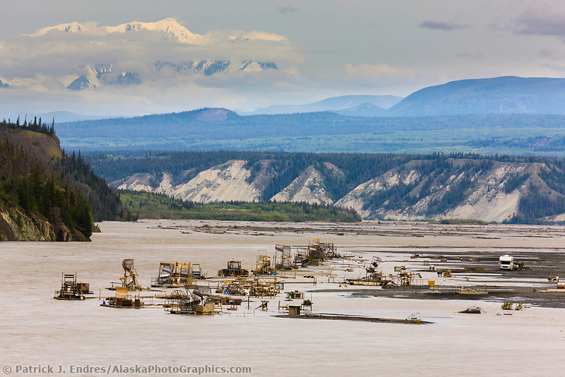 Subsistence use fish wheels along the Copper river catch red and king salmon. Mount Wrangell of the Wrangell mountains in the distance.