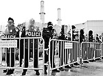 U.S. Capitol Police take up positions at one of the entrances to the Capitol Power Plant as protesters approach to voice opposition to the use of coal in the facility on March 2, 2009.