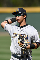 Third baseman Oswaldo Cabrera (10) of the Charleston RiverDogs warms up before a game against the Greenville Drive on Sunday, April 29, 2018, at Fluor Field at the West End in Greenville, South Carolina. Greenville won, 2-0. (Tom Priddy/Four Seam Images)