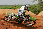 """AMA Supercross star James """"Bubba"""" Stewart practices his craft on a private supercross track at his family's 100-acre farm in Haines City, Fla., Wednesday, April 19, 2006.(AP Photo/Brian Myrick)"""
