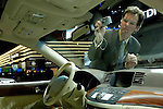 A journalist photographs the interior of the Infiniti M35x at the North American International Auto Show, 2007