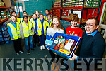 Rose O'Reilly, Courtney Sheehy and Paddy Kevane, with volunteers pictured on Friday last at the launch of the Christmas Day lunch from 2pm, which takes place at St. John's Parish Hall.