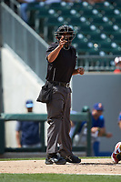 Home plate umpire Erich Bacchus makes a strike call during the International League game between the Durham Bulls and the Charlotte Knights at BB&T BallPark on May 27, 2019 in Charlotte, North Carolina. The Bulls defeated the Knights 10-0. (Brian Westerholt/Four Seam Images)