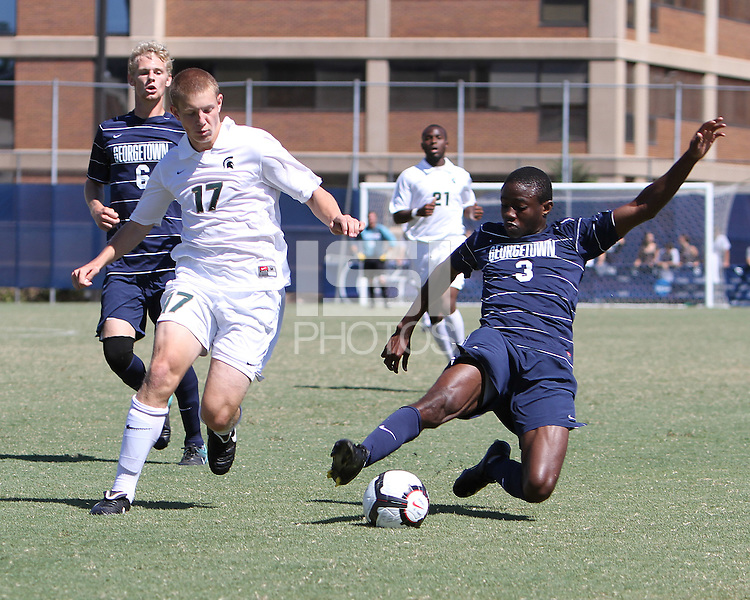 Ibu Oteqbeye #3 of Georgetown University slides the ball away from Josh Barens #17 of Michigan State during an NCAA match at North Kehoe Field, Georgetown University on September 5 2010 in Washington D.C. Georgetown won 4-0.