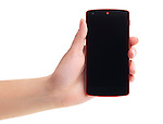 Google Android Nexus 5 phone in woman's hand isolated on white background