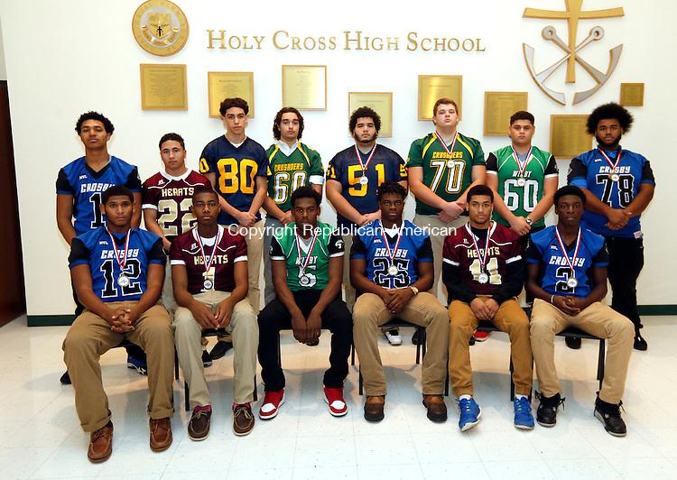 Waterbury, CT- 14 December 2015-121415CM04- The 2015 All-City football offense: front row, from left, Mike Marshall (Crosby), Trey Dawson (Sacred Heart-Kaynor Tech), Darrien Bell (Wilby), Mc Henry (Crosby), Jurrel Racine (Sacred Heart-Kaynor Tech), Eli Mbaya (Crosby); back row, from left, Aaron Hills (Crosby), Joel Guzman (Sacred Heart-Kaynor Tech), Jordan Crosby-Williams (Kennedy), Tyler Cremin (Holy Cross), Jose Cardona (Kennedy), Evan Lovell (Holy Cross), Nestor Meija-Grion (Wilby), Isaiah Lilley (Crosby).     Christopher Massa Republican-American