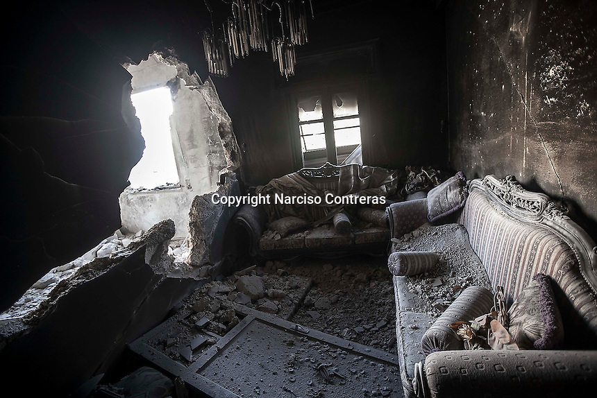 In this Sunday, Oct. 28, 2012 photo. An apartment shattered by tank shelling is viewed at the top level of one house building in Karmal Jabl neighborhood after several days of intense clashes between rebel fighters and the Syrian army in Aleppo City. (AP Photo/Narciso Contreras).