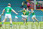 Limerick duo Aidan O'Sullivan and Eddie Mulcahy fail to stop the advance of Gary Sayers in the Munster Junior Championship Semi final held in the Gaelic Grounds last Saturday.